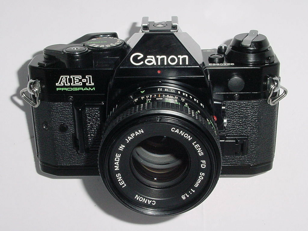 Canon AE-1 Program 35mm SLR Film MANUAL Camera + Canon 50mm F1.8 FD Lens - Black